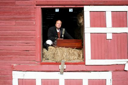 man in barn